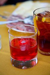 Close up of glass of Campari aperitif and appetizers