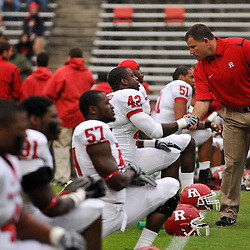 Sep 26, 2009; College Park, MD, USA; Rutgers head coach Greg Schiano shakes hands with players during warmups before Rutgers' 34-13 victory over Maryland in NCAA college football at Byrd Stadium.
