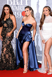 Jesy Nelson, Perrie Edwards, Jade Thirlwall of Little Mix attending the Brit Awards 2019 at the O2 Arena, London. Photo credit should read: Doug Peters/EMPICS Entertainment. EDITORIAL USE ONLY