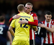 Oli McBurnie of Sheffield Utd consoles Aaron Ramsdale of Bournemouth during the Premier League match at Bramall Lane, Sheffield. Picture date: 9th February 2020. Picture credit should read: Simon Bellis/Sportimage