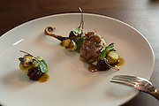 New York, NY, - December 8, 2013.  Quail with black berries, bread sauce and roasted onions at The Musket Room, 265 Elizabeth St.