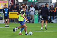 AFC Wimbledon midfielder Anthony Hartigan (8) warming up in front of the cup during the EFL Carabao Cup 2nd round match between AFC Wimbledon and West Ham United at the Cherry Red Records Stadium, Kingston, England on 28 August 2018.