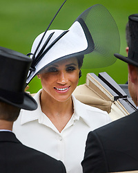 © Licensed to London News Pictures. 19/06/2018. London, UK.  Meghan, Duchess of Sussex arrives for Day one of Royal Ascot at Ascot racecourse in Berkshire, on June 19, 2018. The 5 day showcase event, which is one of the highlights of the racing calendar, has been held at the famous Berkshire course since 1711 and tradition is a hallmark of the meeting. Top hats and tails remain compulsory in parts of the course. Photo credit: Ben Cawthra/LNP
