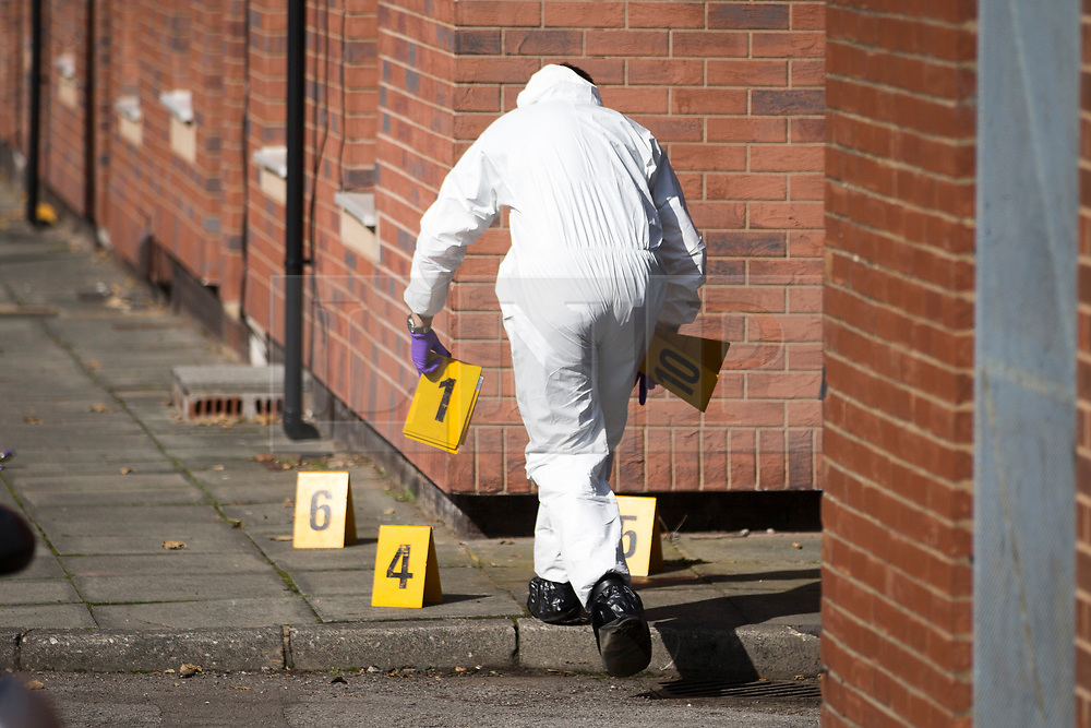 © Licensed to London News Pictures. 19/09/2017. Hexthorpe UK. Picture shows police forensic officers at the scene in Hexthorpe where a police officer has been seriously injured in an attack on Sheardown street in Hexthorpe, Doncaster. Two men & a woman have been arrested over the incident, the full extent of the officers injuries is not known yet. South Yorkshire Police said they were called to reports of a vehicle crash at about 07:30 the officer was assaulted when three people fled the area.  Photo credit: Andrew McCaren/LNP