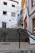 Rua Ferreira Borges passes through the Arco de Almedina. Coimbra, Portugal