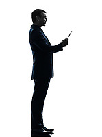 one  business man smiling holding digital tablet in silhouette on white background