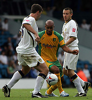 Photo: Paul Thomas.<br /> Leeds United v Norwich City. Coca Cola Championship.<br /> 05/08/2006.<br /> <br /> Leon McKenzie (C) tries to win the ball for Norwich.