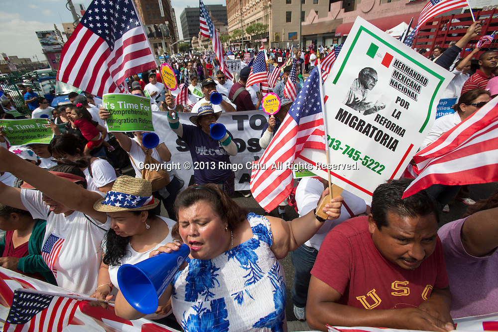 Thousands of people participate in the May Day march and rally on May 1, 2013 in Los Angeles, United States. In celebration of May Day, people have gathered across the country to rally for various topics including immigration reform.  (Photo by Ringo Chiu/PHOTOFORMULA.com)...