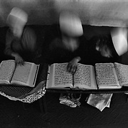 Young boys memorize the Qur'an (Koran) and bob their heads back and forth as they recite passages in Arabic in a Madrasah (Madrassa), which means school in Arabic. In the west a Madrasah usually refers to an Islamic religious school often misunderstood as a place that produces religious extrememists. A Madrasah is  a place where mostly young men go to learn the Qur'an, many go on to become Imam's which are spiritual leaders in mosques and communities. (Credit Image: © Louie Palu/ZUMA Press/The Alexia Foundation).Sept. 15, 2010.Photograph taken on film exact date estimated and not known.....
