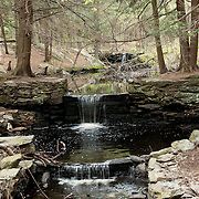 Old mill pond and waterfall at the Massachusetts Audubon Broadmor Wildlife Sanctuary, South Natick, Massachusetts