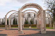 Fermentation tanks. Modern sculptured arches. Bronze sculpture of Abraham Lincoln by Charles Keck.  Bacalhoa Vinhos, Azeitao, Portugal