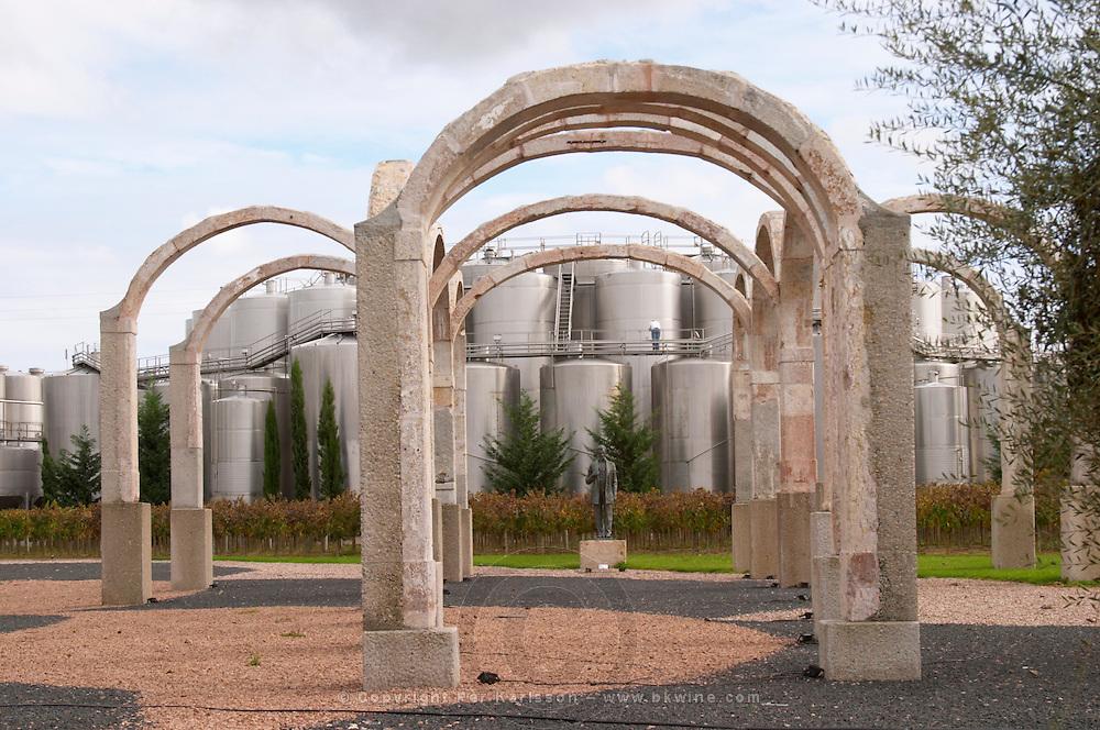 Fermentation tanks. Modern sculptured arches. Bronze sculpture of Abraham Lincoln by Charles Keck.  Bacalhoa Vinhos, Azeitao, Portugal