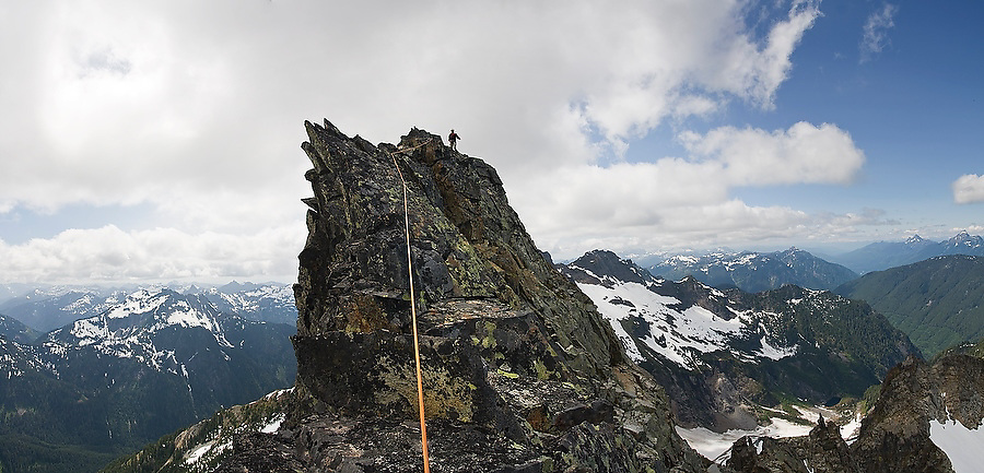 Climber Brian Polagye leads the final pitch on the spectacular narrow summit ridge of Foggy Peak in the Monte Cristo area, Mount Baker-Snoqualmie National Forest, Washington on June 28, 2009.