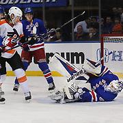 Henrik Lundqvist, Rangers, makes a save during the New York Rangers Vs Philadelphia Flyers, NHL regular season game at Madison Square Garden, New York, USA. 26th March 2014. Photo Tim Clayton