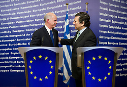 """George Papandreou, Greece's prime minister, left, and Jose Manuel Barroso, president of the European Commission, depart after a press briefing that followed their meeting at the European Union Commission headquarters in Brussels, Belgium, on Wednesday, March 17, 2010. German Chancellor Angela Merkel said the European Union must avoid any """"overly hasty"""" aid pledge to Greece. (Photo © Jock Fistick)"""
