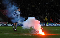 SOUTHAMPTON V MANCHESTER UNITED FAC6 12/03/05<br />GAME IS HALTED BY REFEREE  HOWARD WEBB AS A FLARE IS THROWN ON PITCH FROM MANCHESTER UNITED SECTION  AND LANDS  NEAR  PAUL SMITH <br />Photo Roger Parker Fotosports International