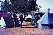 British tourists campsite on the coast with tents camping holiday in Spain, 1966