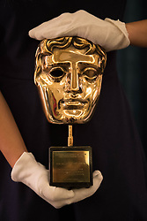 Embargoed to 0001 Friday July 21<br /> An honorary BAFTA Award presented to the Queen in 2013 on the display of gifts presented to Queen Elizabeth II throughout her 65 year reign on show during a preview for the Royal Gifts exhibition, which is part of the annual Summer Opening of the State Rooms at Buckingham Palace, London.
