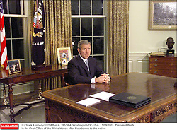 © Chuck Kennedy/KRT/ABACA. 28534-4. Washington-DC-USA, 11/09/2001. President Bush in the Oval Office of the White House after his address to the nation  | 28534_04