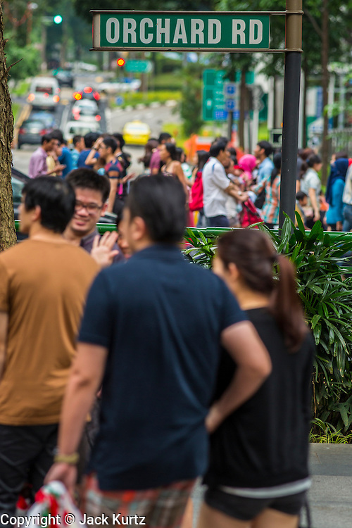 "22 DECEMBER 2012 - SINGAPORE, SINGAPORE:  People walk up Orchard Road during Christmas celebrations in Singapore. Orchard Road, Singapore's famed shopping street, sponsors the annual event, called ""Christmas on a Great Street."" The street is decorated with holiday lights, stores stay open late and crowds pack the area. This is the 8th year Singapore has held the ""Christmas on a Great Street"" event.   PHOTO BY JACK KURTZ"