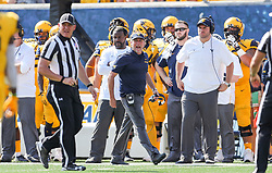 Oct 6, 2018; Morgantown, WV, USA; West Virginia Mountaineers head coach Dana Holgorsen yells at a referee from the sidelines during the second quarter against the Kansas Jayhawks at Mountaineer Field at Milan Puskar Stadium. Mandatory Credit: Ben Queen-USA TODAY Sports