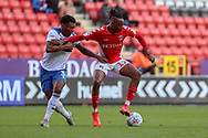 Charlton Athletic midfielder Joe Aribo (17) holding off Rochdale defender Kgosi Ntlhe (3) during the EFL Sky Bet League 1 match between Charlton Athletic and Rochdale at The Valley, London, England on 4 May 2019.
