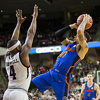 Florida guard Chris Chiozza (11) takes a shot against Texas A&M guard JJ Caldwell (4) during the second half of an NCAA college basketball game Tuesday, Jan. 2, 2018, in College Station, Texas. (AP Photo/Sam Craft)