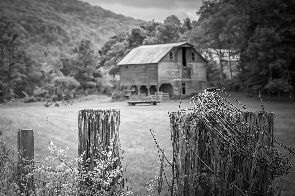 A the base of a mountain, this beautiful old farm stands centry of the only road up.