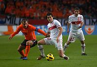 Football - International Friendly The Netherlands vs Turkey. Nuri Sahin attacks in front of Rafael van der Vaart.