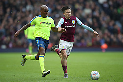 Derby County's Andre Wisdom holds off challenge from Aston Villa's Jack Grealish