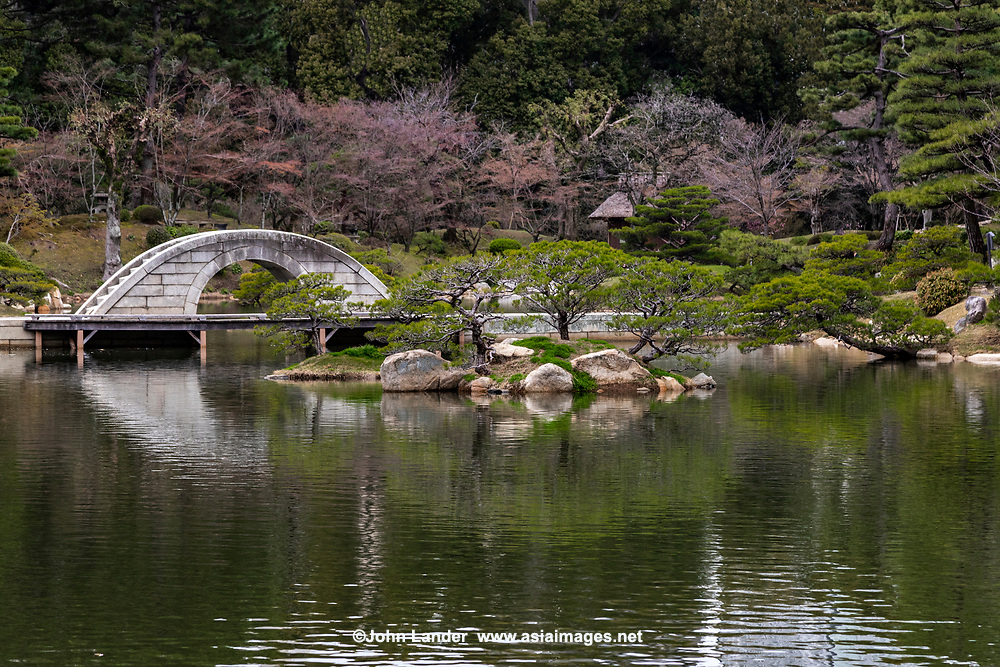 Kokokyo Bridge at Shukkeien Garden - Shukkeien garden was built in 1620 by Ueda Soko - a warrior who became a Buddhist monk, tea master and landscape gardener.  It was designed and built for the villa of Asano Nagaakira, daimyo of Hiroshima.  Shukkeien distorts concepts of space, cramming a miniaturized version of the landscape of West Lake Hangzhou China into a space of just 40,000 square meters.  Even its name means shrunken-scenery garden. Shukkeien contains many of the elements of classic landscape gardens introduced from China by Zen priest Muso Kokushi: evocatively shaped rocks, pavilions and a large pond with small islands. Around Takuei Pond with its hump-backed Rainbow Bridge winding paths lead visitors through miniature mountains, valleys, fields and groves.  Shukkeien's Seifukan teahouse, with its thatched roof and lyre-shaped window, a different tea ceremony is held each month to celebrate the flowers of each successive season.