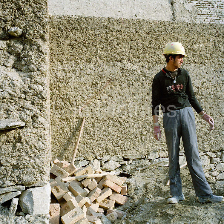 """Sayed Mohammed, 18, a mason's assistant is responsible for plastering the walls, during the renovation of the old city district of Murad Khane. He is using a traditional mud-based render made out of gravel, straw and mud. <br /> """"The builders tread the mud, straw and gravel mixture for a couple of days to make it strong"""" he says. """"It's tougher than concrete when it's finished."""" . <br /> <br /> Sayed dreams of being a good mason, having a car and a family. He has been working since he was ten when he used to sell fruit during the Taliban years, he has no education.  Murad Khane, the ancient centre of Kabul is undergoing a massive regeneration thanks to the Turquoise Mountain Foundation. The foundation was set up by Steward Rory Stewart, the man who's life has inspired a Hollywood biopic starring Orlando Bloom. He walked across Afghanistan with his dog, governed a province in  Iraq , tutored Prince William and Harry and was asked personally by Prince Charles to undertake the project of regenerating the heart of the old city centre. Two years later, the project has galvanized the local community who have all been offered work. The organization has cleared some 20,000 tons of rotting garbage from the streets, built a primary school, a clinic and restored several of the finest courtyard homes to near-mint condition. With an eye for capacity building Stewart has also developed a school for traditional crafts,"""