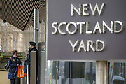 A member of MET Police is seen at the entry of New Scotland Yard building in central London, on Tuesday, Feb 25, 2020. (Photo/Vudi Xhymshiti)