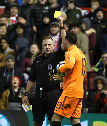 07 January 2018 FA Cup 3rd round Nottingham - Nottingham Forest v Arsenal - referee Jonathan Moss shows the yellow card to Arsenal goalkeeper David Ospina.<br /> (photo by Mark Leech)