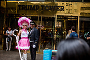 New York, NY - April 16, 2017. A man dressed as Little Bo Beep poses with a doorman in front of Trump Tower  at New York's annual Easter Bonnet Parade and Festival on Fifth Avenue.