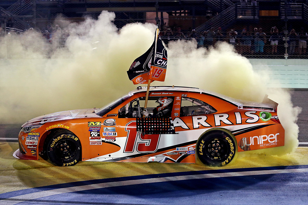 Nov 19, 2016; Homestead, FL, USA; NASCAR Xfinity Series driver Daniel Suarez (19) celebrates winning the NASCAR Xfinity Series championship after the Ford Ecoboost 300 at Homestead-Miami Speedway. Mandatory Credit: Peter Casey-USA TODAY Sports