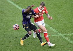 West Ham's Enner Valencia wins the ball from Bristol City's Aden Flint - Photo mandatory by-line: Alex James/JMP - Mobile: 07966 386802 - 25/01/2015 - SPORT - Football - Bristol - Ashton Gate - Bristol City v West Ham United - FA Cup Fourth Round