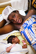 Golda Aggor lies in bed with her four-year-old daughter at the La Polyclinic in Accra, Ghana on Tuesday June 16, 2009.