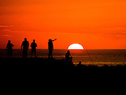 A fisherman silhoutted against the setting sun Aguadilla Puerto Rico