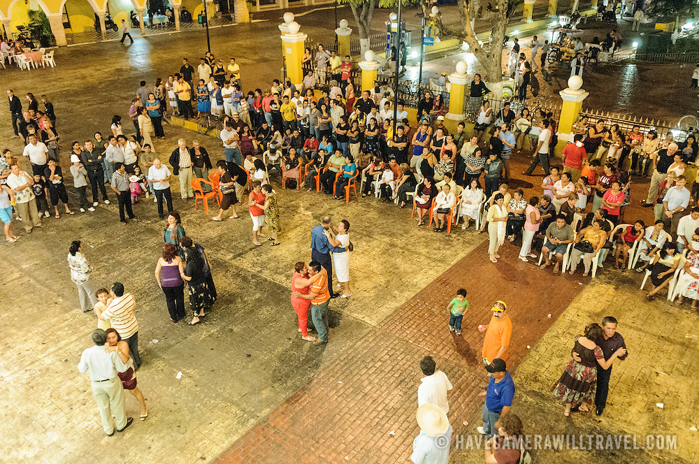 Audience members dancing as oart of the celebrations next to main square for the Queen of the Maya 2011 Festival in downtown Valladolid, a colonial town in the heart of Mexico's Yucatan Peninsula.