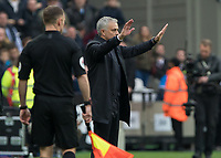 Football - 2019 / 2020 Premier League - West Ham United vs. Tottenham Hotspur<br /> <br /> Jose Mourinho, Manager of Tottenham FC, acts as peacemaker as he calls for calm ampngst his players at the London Stadium<br /> <br /> COLORSPORT/DANIEL BEARHAM