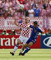 Photo: Chris Ratcliffe.<br /> Japan v Croatia. Group F, FIFA World Cup 2006. 18/06/2006.<br /> Niko Kranjcar of Croatia clashes with Mitsuo Ogasawara of Japan.