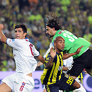 Fenerbahce's Deivid de SOUZA (C) and Trabzonspo's Ceyhun GULSELAM (L), goalkeeper Onur Recep KIVRAK (R) during their Turkish superleague soccer derby match Fenerbahce between Trabzonspor at the Sukru Saracaoglu stadium in Istanbul Turkey on Sunday 16 May 2010. Photo by TURKPIX