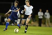 Fotball, 21. februar 2004, La Manga, Rosenborg-Dynamo Kiev 4-4,  Jan Gunnar Solli, Rosenborg, og Kleber, Dynamo Kiev