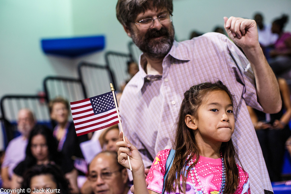 04 JULY 2012 - PHOENIX, AZ: Spectators watch for family members walking into the naturalization ceremony at South Mountain Community College in Phoenix Wednesday. About 250 people, from 62 countries, were naturalized as US citizens during the 24th Annual Fiesta of Independence naturization ceremony at South Mountain Community College in Phoenix Wednesday. The ceremony was presided over by the Honorable Roslyn O. Silver, Chief United States District Court Judge.    PHOTO BY JACK KURTZ