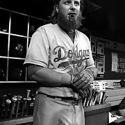 Justin Turner, Los Angeles Dodgers, in the dugout preparing to bat during the New York Mets Vs Los Angeles Dodgers MLB regular season baseball game at Citi Field, Queens, New York. USA. 25th July 2015. Photo Tim Clayton