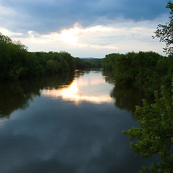 The Connecticut River at sunset as seen from the the Norwottock Rail Trail in Northampton, Massachusetts.