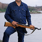 Bud Natus is a ranch manager who has been shot at while working the property that ends at the Rio Grande river. On the other side is Mexico and Natus says he now arms himself against migrant smugglers and drug smugglers who cross the river and the ranch into the U.S. Please contact Todd Bigelow directly with your licensing requests.