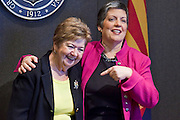 12 JANUARY 2009 -- PHOENIX, AZ: Jacquee Wright (CQ) LEFT, of the Governor's staff, and Gov Janet Napolitano joke with each other in the Governor's office Monday before she delivered her State of the State address. Arizona Governor Janet Napolitano delivered her last State of the State Monday. She has been nominated to be Secretary of Homeland Security by US President-Elect Barack Obama is expected to be approved by the US Senate next week. She is expected to resign as Arizona Governor after she is approved by the Senate.  PHOTO BY JACK KURTZ