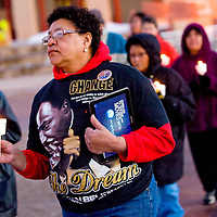 012013       Cable Hoover<br /> <br /> Event organizer Mona Frazier joins in a march around the McKinley County Courthouse plaza during the Martin Luther King day rally in Gallup.